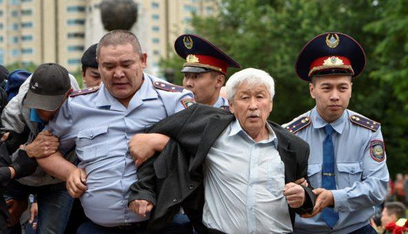 Police officers detain an opposition supporter during a protest against presidential election, in Almaty, Kazakhstan, June 9, 2019.  REUTERS/Mariya Gordeyeva