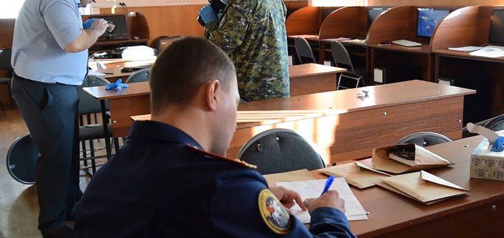"BLAGOVESHCHENSK, RUSSIA -- NOVEMBER 14, 2019: Russian Investigative Committee officers inside the building of the Amur Region Construction and Utility Operations Vocational School (GPOAU AKSZhKKh) in the city of Blagoveshchensk, Amur Region, after a shooting incident in which a 19-year-old student opened fire from a shotgun killing one person and injuring three other people; the attacker died; the incident took place at around 10am local time. Investigative Committee of the Russian Federation/TASS  –осси€. јмурска€ область. Ѕлаговещенск. —ледователи —ледственного комитета –' в здании јмурского колледжа строительства и коммунального хоз€йства, где студент во врем€ учебного зан€ти€ открыл стрельбу. ¬ результате стрельбы погиб один человек, еще три человека получили ранени€. Ќападавший погиб. —нимок с видео. —ледственный комитет –'/""ј——"