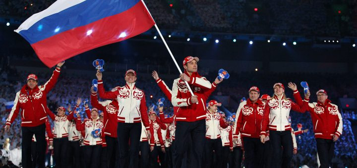 VANCOUVER, BC - FEBRUARY 12:  Flagbearer Alexey Morozov of Russian Federation leads his team into the stadium during the Opening Ceremony of the 2010 Vancouver Winter Olympics at BC Place on February 12, 2010 in Vancouver, Canada.  (Photo by Cameron Spencer/Getty Images)