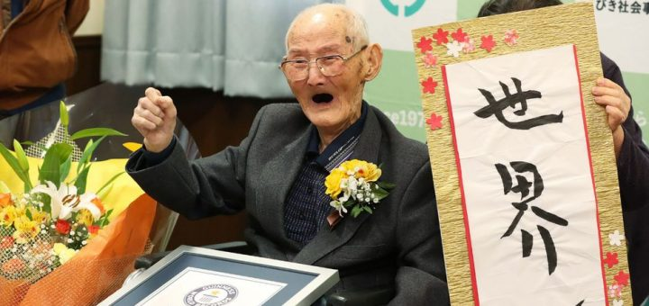 TOPSHOT - CORRECTION - In this Japan Pool picture received via Jiji Press on February 12, 2020, 112-year-old Japanese man Chitetsu Watanabe poses next to calligraphy reading in Japanese 'World Number One' after he was awarded as the world's oldest living male in Joetsu, Niigata prefecture. - The 112-year-old Japanese man who believes smiling is the key to longevity has been recognised as the world's oldest male, Guinness World Records said on February 12. (Photo by JAPAN POOL / JIJI PRESS / AFP) / Japan OUT / ôThe erroneous mention[s] appearing in the metadata of this photo by STR has been modified in AFP systems in the following manner: [Japan Pool picture received via Jiji Press] instead of [Guineess World Records LTD. via Jiji Press]. Please immediately remove the erroneous mention[s] from all your online services and delete it (them) from your servers. If you have been authorized by AFP to distribute it (them) to third parties, please ensure that the same actions are carried out by them. Failure to promptly comply with these instructions will entail liability on your part for any continued or post notification usage. Therefore we thank you very much for all your attention and prompt action. We are sorry for the inconvenience this notification may cause and remain at your disposal for any further information you may require.ö