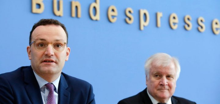 German Health Minister Jens Spahn, left, and Interior Minister Horst Seehofer brief the media during a new conference in Berlin, Germany, Thursday, Feb. 27, 2020. The German government inform about the new coronavirus COVID-19 outbreak in Germany. (AP Photo/Markus Schreiber)